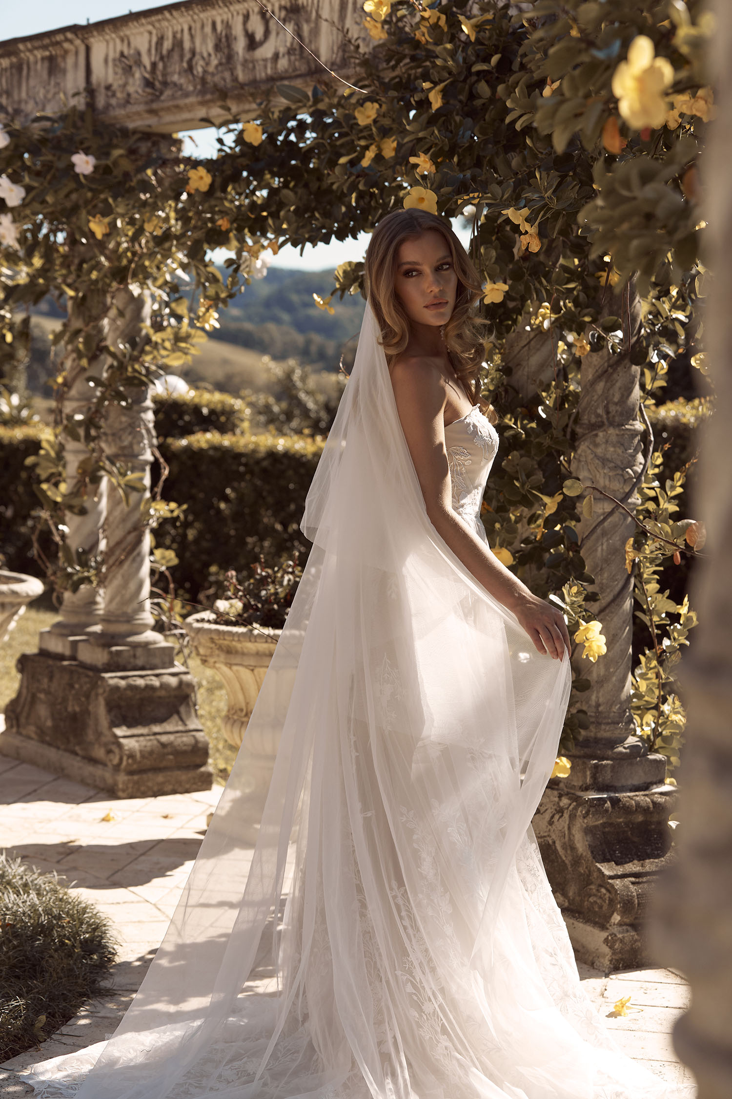 BRIELLE VEIL V955 TWO TIERED CATHEDRAL LENGTH WITH LACE APPLIQUES EDGE PAIRED WITH GOWN ML19255 VEIL MADI LANE BRIDAL2