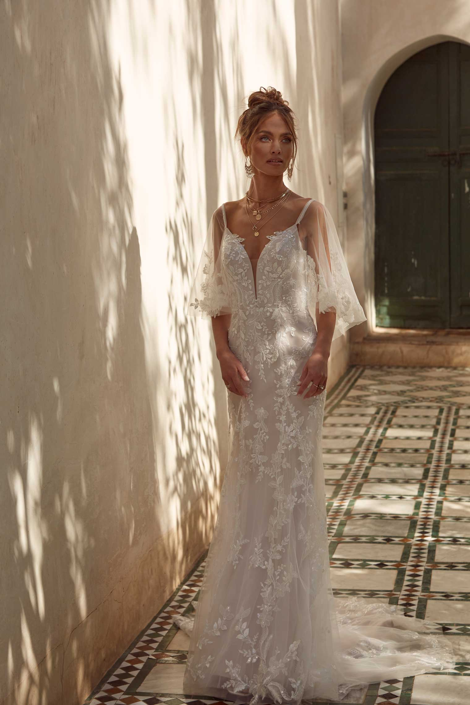 AVA-ML17121-FULL-LENGTH-FITTED-LACE-GOWN-WITH-PLUNGING-NECK-AND-LOW-BACK-WITH-DETACHABLE-CAPE-AND-BELT-WEDDING-DRESS-MADI-LANE-BRIDAL5