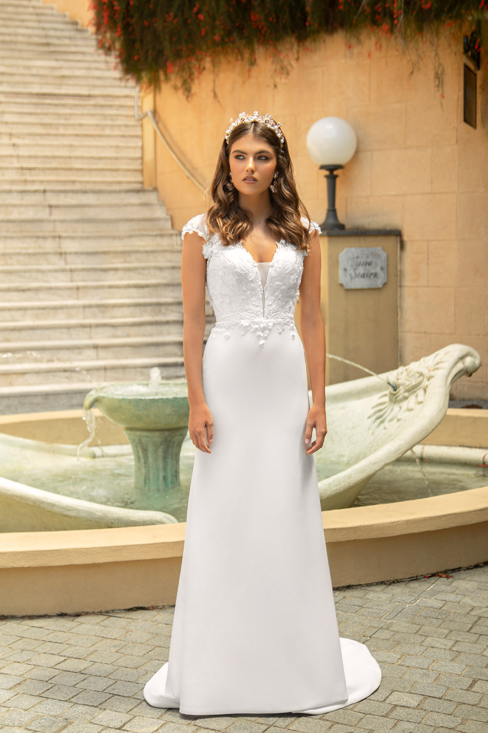 BLOSSOM-ROSE ML19603 DEEP PLUNGE BODICE WITH ILLUSION TULLE CAP SLEEVES AND ILLUSION BACK WITH BUTTONS FITTED CREPE SKIRT WEDDING DRESS MADI LANE BRIDAL