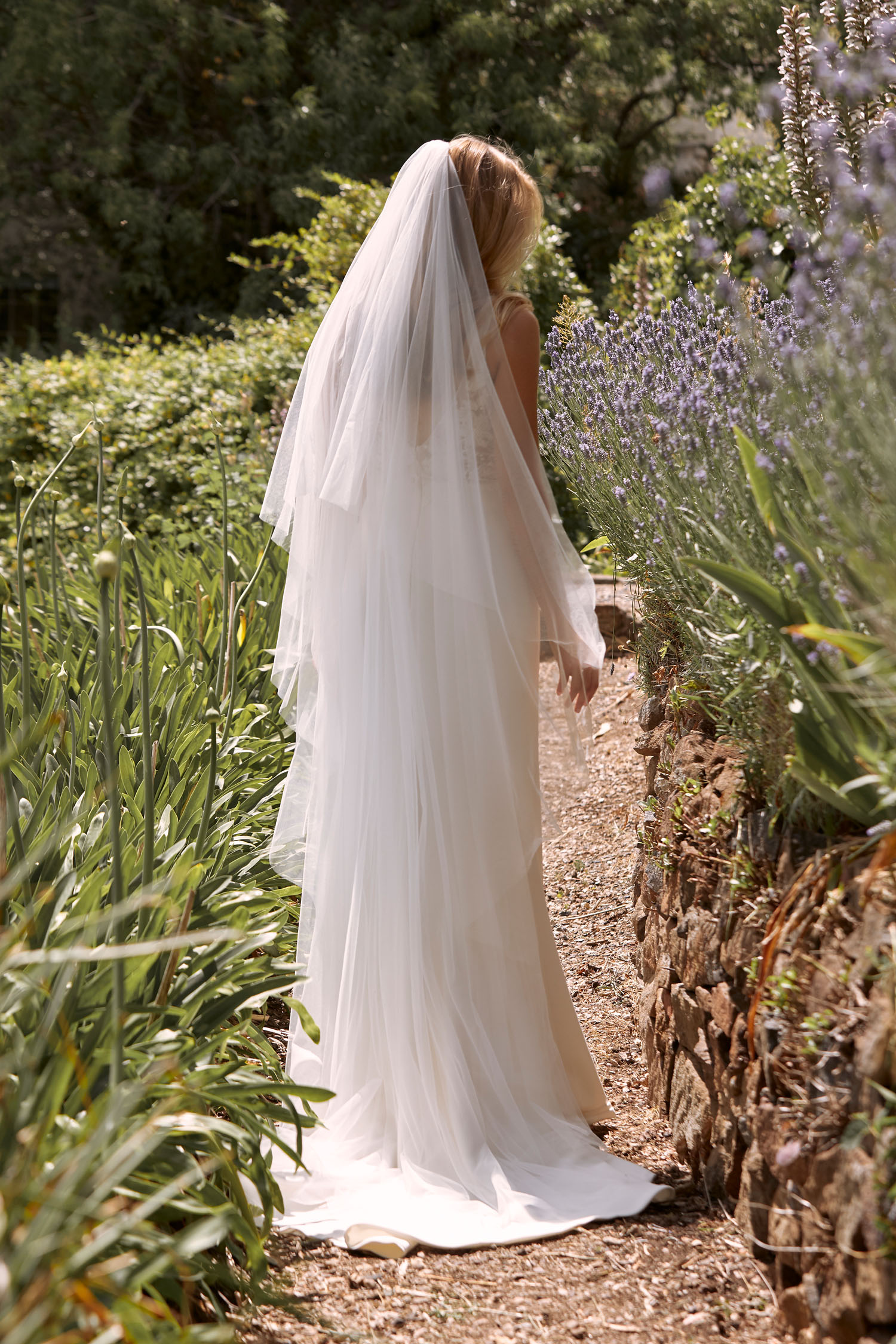 CODY-ML21015-FULL-LENGTH-FITTED-CREPE-SKIRT-GOWN-WITH-ILLUSION-FLORAL-LACE-BODICE-AND-STRAPS-ZIPPER-CLOSURE-MATCHING-VEIL-WEDDING-DRESS-MADI-LANE-BRIDAL-3