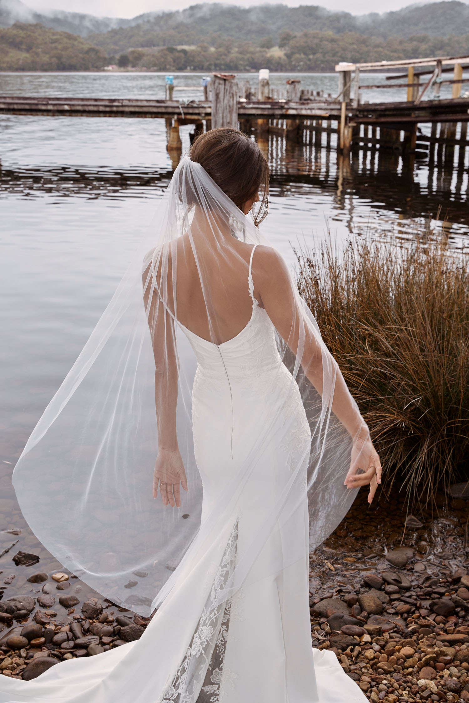 CONNOR-ML20025-FULL-LENGTH-CREPE-GOWN-WITH-V-NECKLINE-THIN-STRAPS-LACE-APPLIQUES-SCOOP-BACK-ZIPPER-CLOSURE-WEDDING-DRESS-MATCHING-VEIL-MADI-LANE-BRIDAL-10