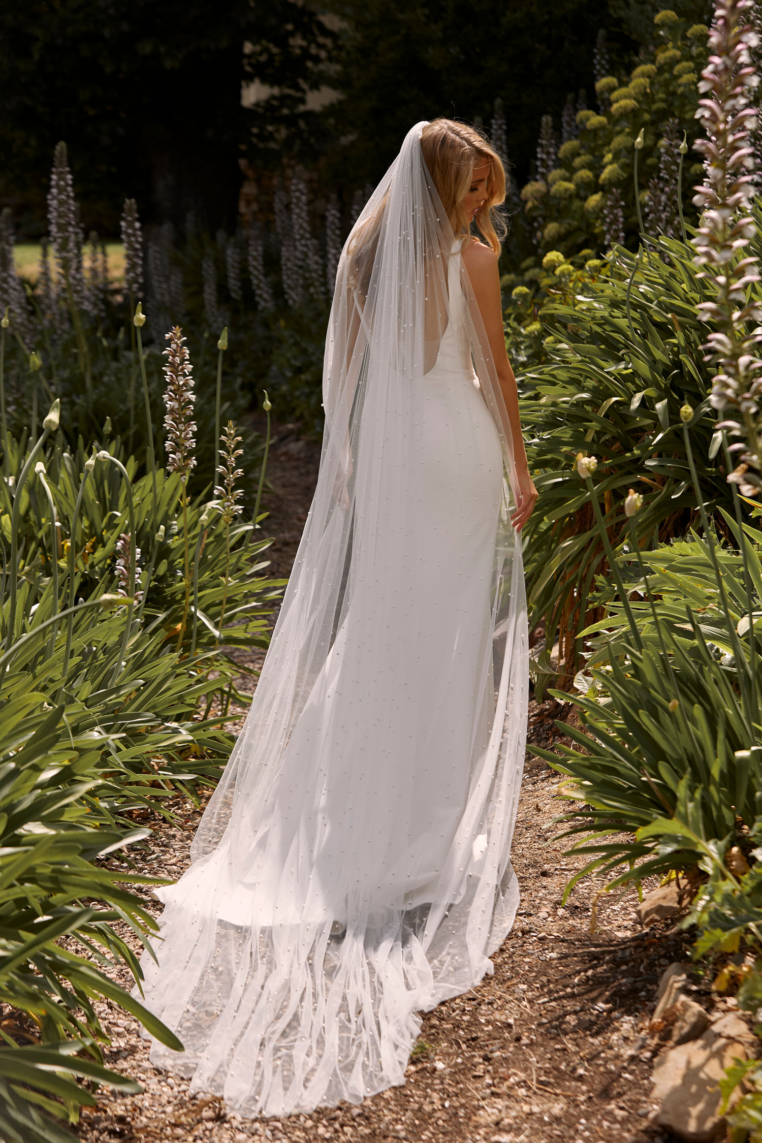 COOPER-ML21020-FULL-LENGTH-FITTED-CREPE-GOWN-WITH-PLUNGING-NECKLINE-STRAPS-LOW-BACK-WITH-ILLUSION-AND-BUTTON-BACK-ZIPPER-IN-SKIRTWEDDING-DRESS-MADI-LANE-BRIDAL.