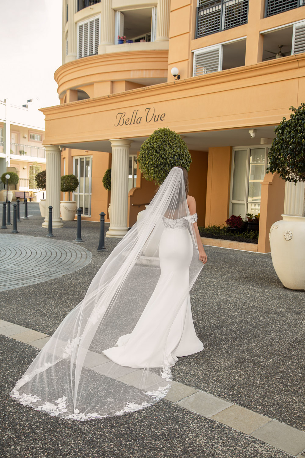 ELORA-MAE-ML19600-SOFT-SCOOP-NECKLINE-FLORAL-LACE-BODICE-GOWN-WITH-FITTED-CREPE-SKIRT-AND-DETACHABLE-OFF-SHOULDER-STRAPS-MATCHING-VEIL-WEDDING-DRESS-MADI-LANE-BRIDAL6